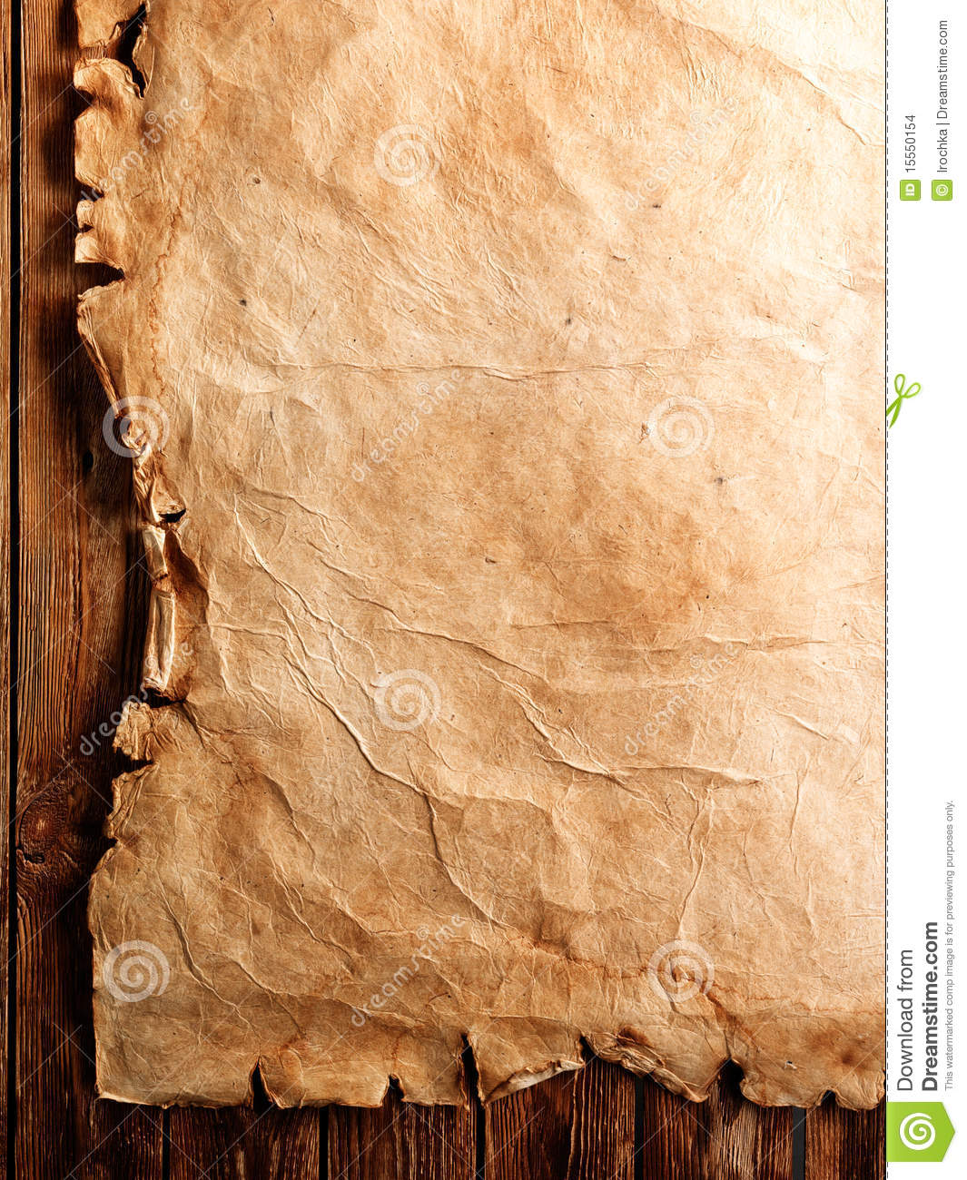 Piece Of Tattered Old Parchment Paper Laying On A Wooden Surface Antique