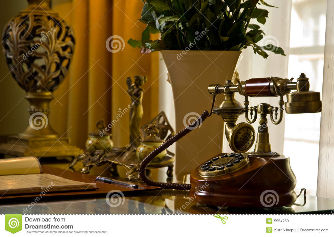 Antique phone on a desk - Antique Phone On A Desk Stock Image. Image Of Antiques - 5554259