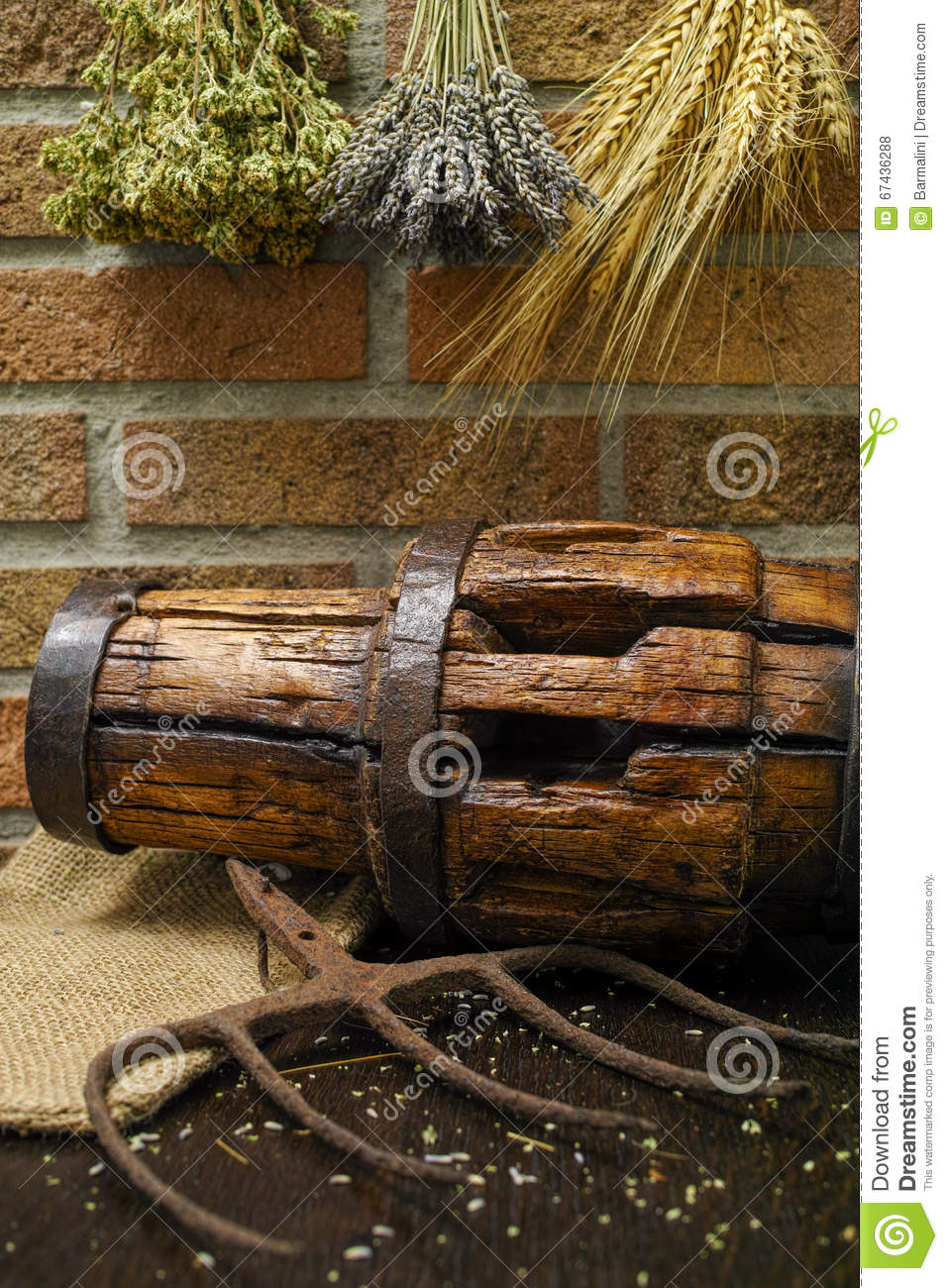 Antique Pitchfork And Wooden Wheel Hub On Burlap Sack Stock Photo