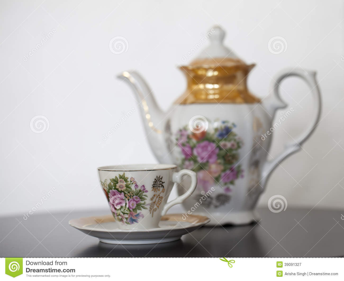 Antique Porcelain Teapot With Cup And Saucer Stock Image