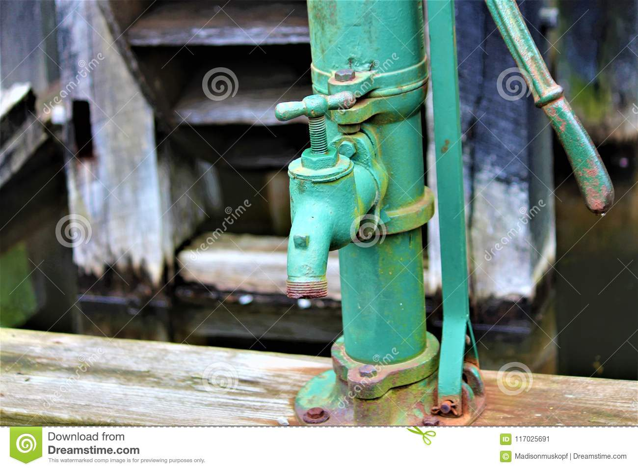Antique Water Pump stock image. Image of green, isolated - 117025691