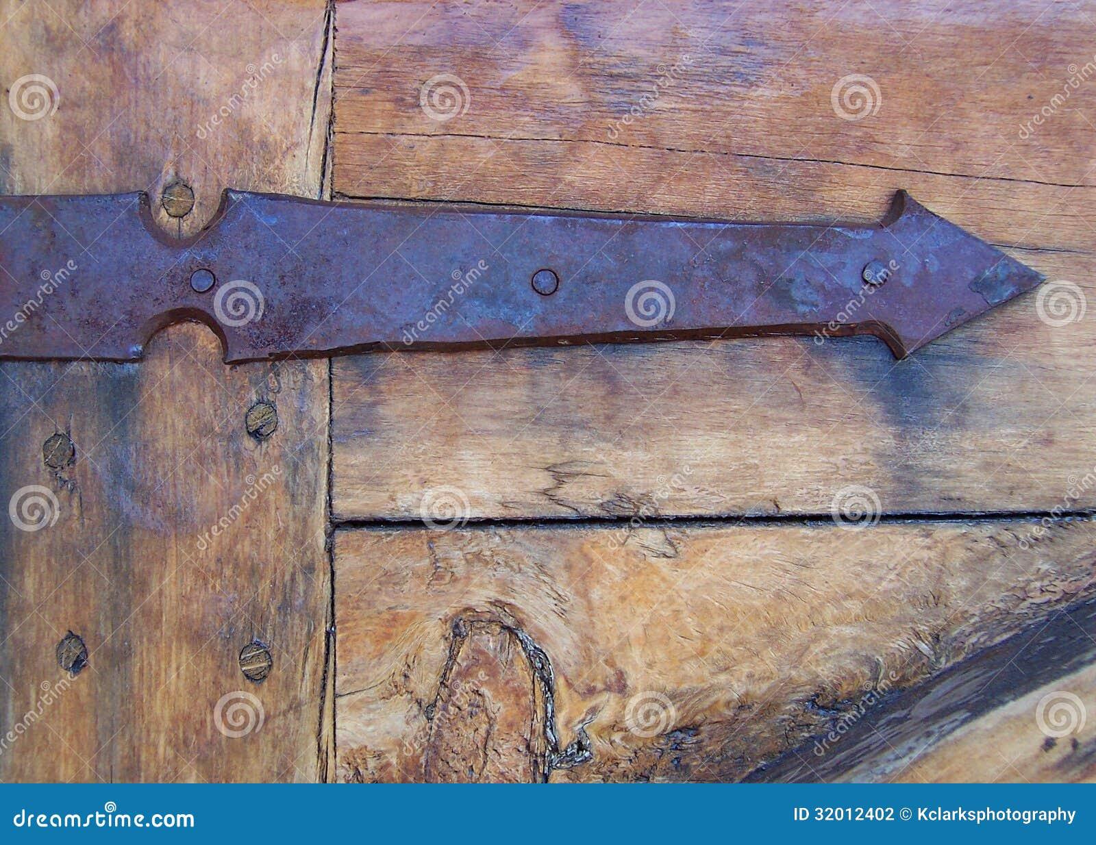 Antique Rusty Arrow Hinge And Door Stock Photography