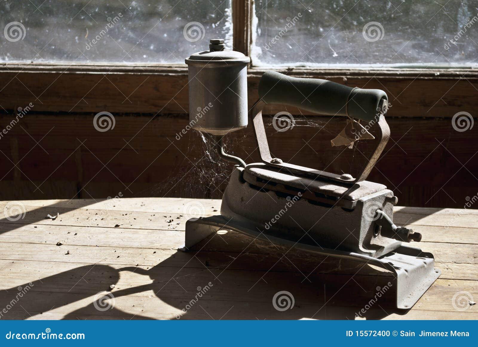 Old Steam Iron ~ Antique steam iron stock photo image