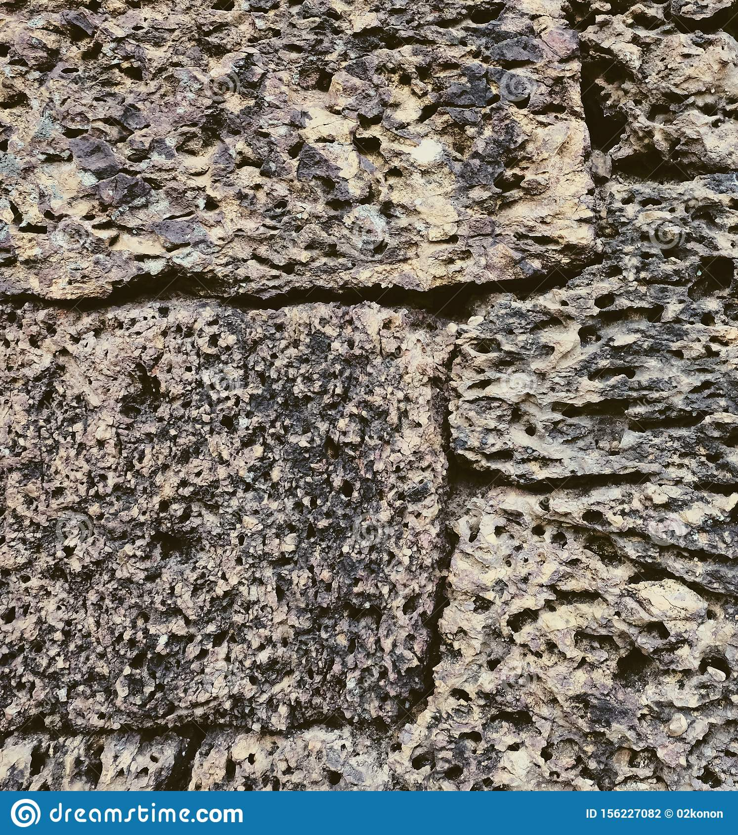 Antique stonework. Stone wall as background. Solid surface