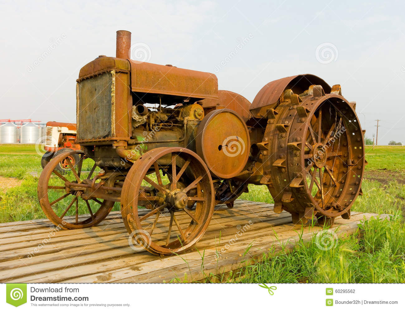 Antique Tractors Equipment : An antique tractor with spiked iron wheels at