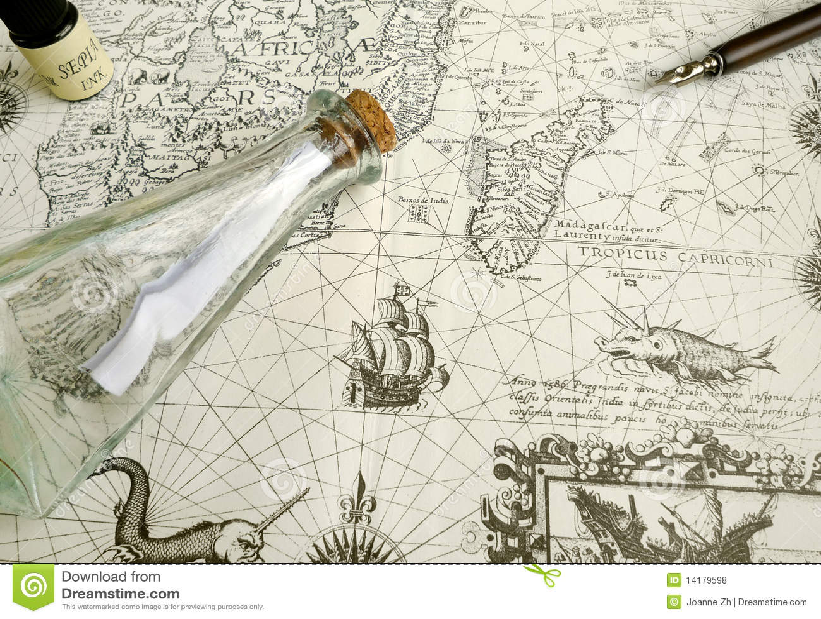 Antique treasure map and manuscript pen