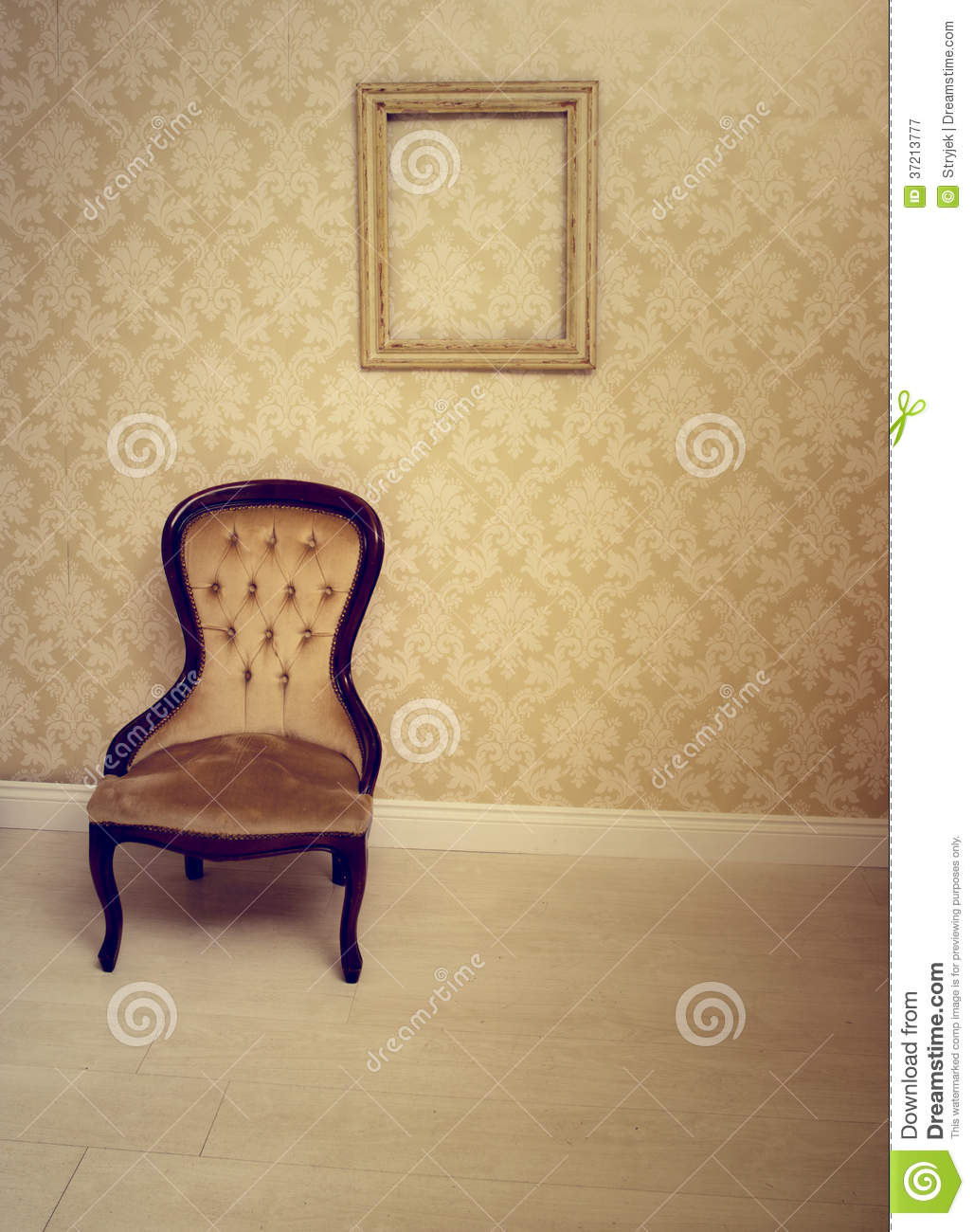 Antique upholstered chair in a wallpapered room - Antique Upholstered Chair In A Wallpapered Room Stock Image
