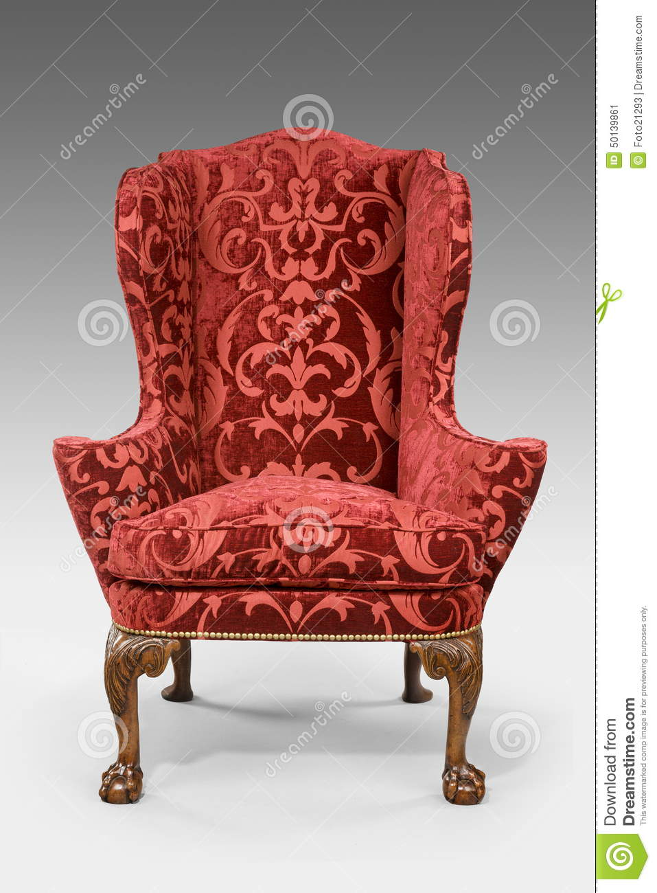Antique upholstered wing chair carved legs isolated with clip pa