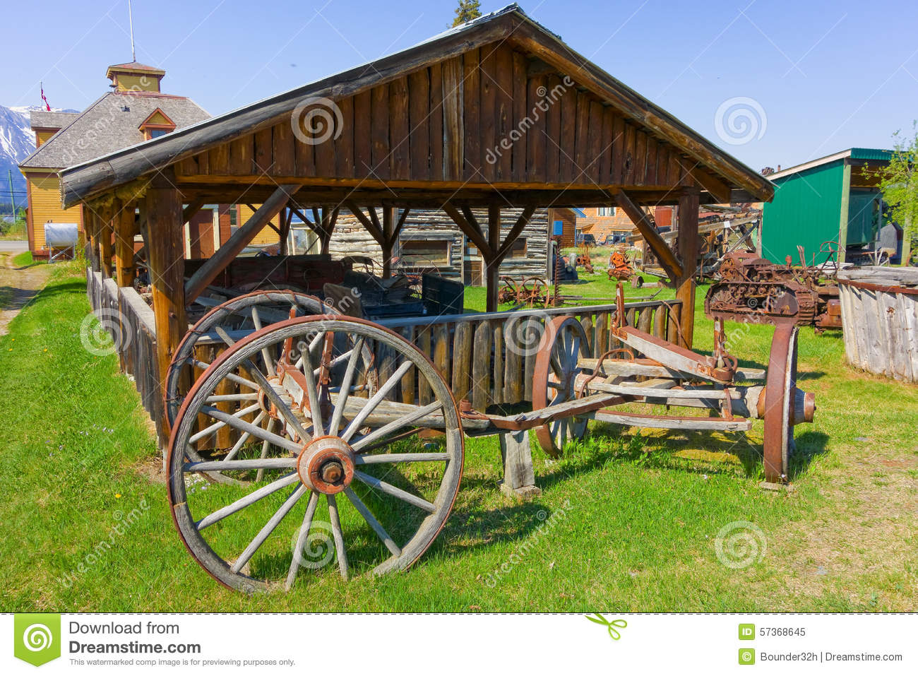 An Antique Wagon On Display At An Outdoor Museum In