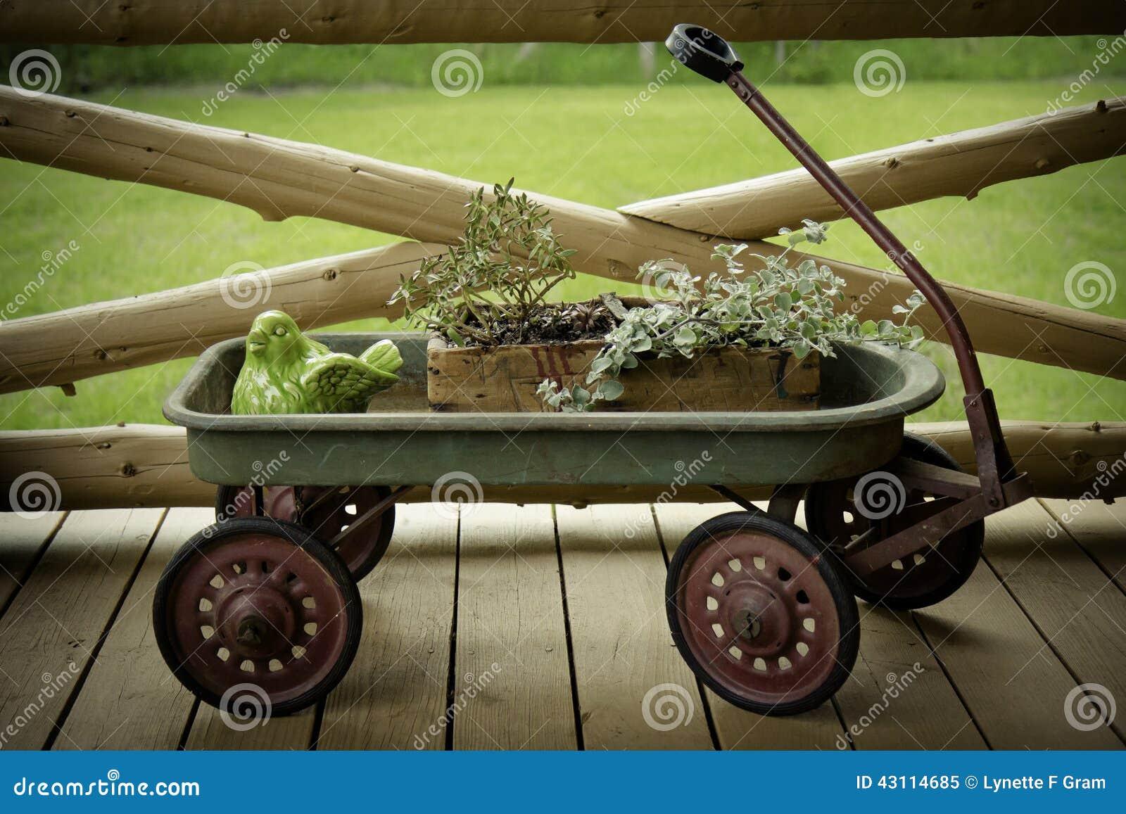 Antique Wagon Flower Display Stock Image - Image of bird, porch ...