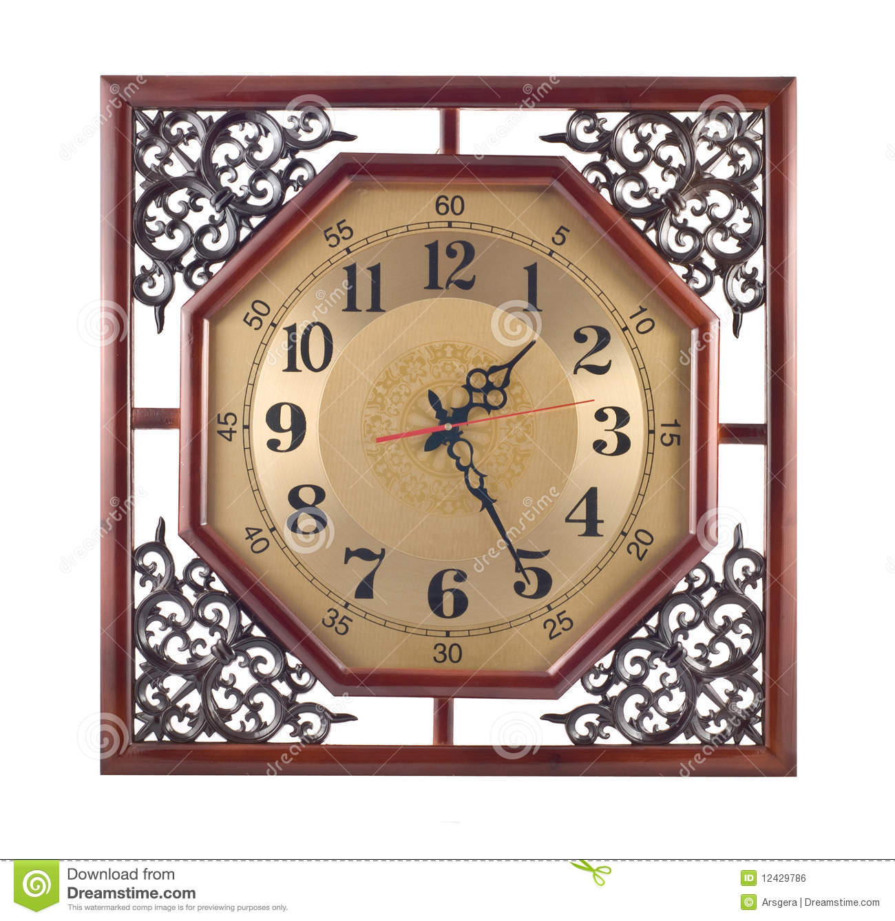 Antique wall clock with carved wooden frame stock photo