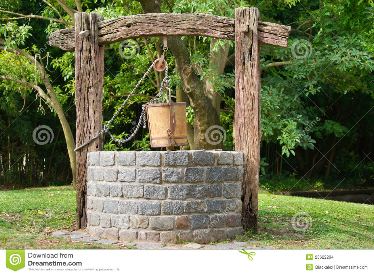 Water well stock photo image of pulley wood stone for Well pictures
