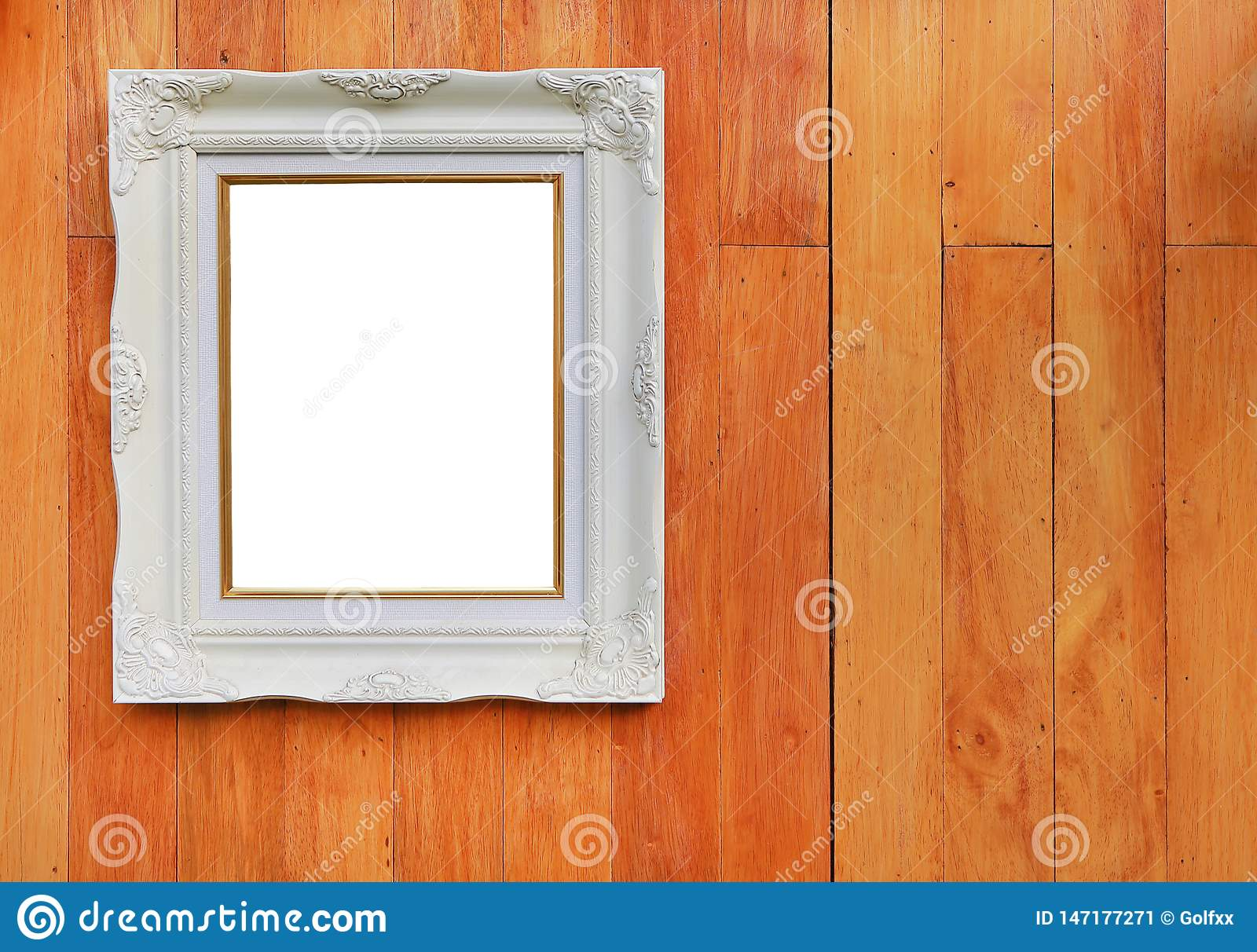 Antique white photo frame with empty space for your picture or text placed on wood plank wall background