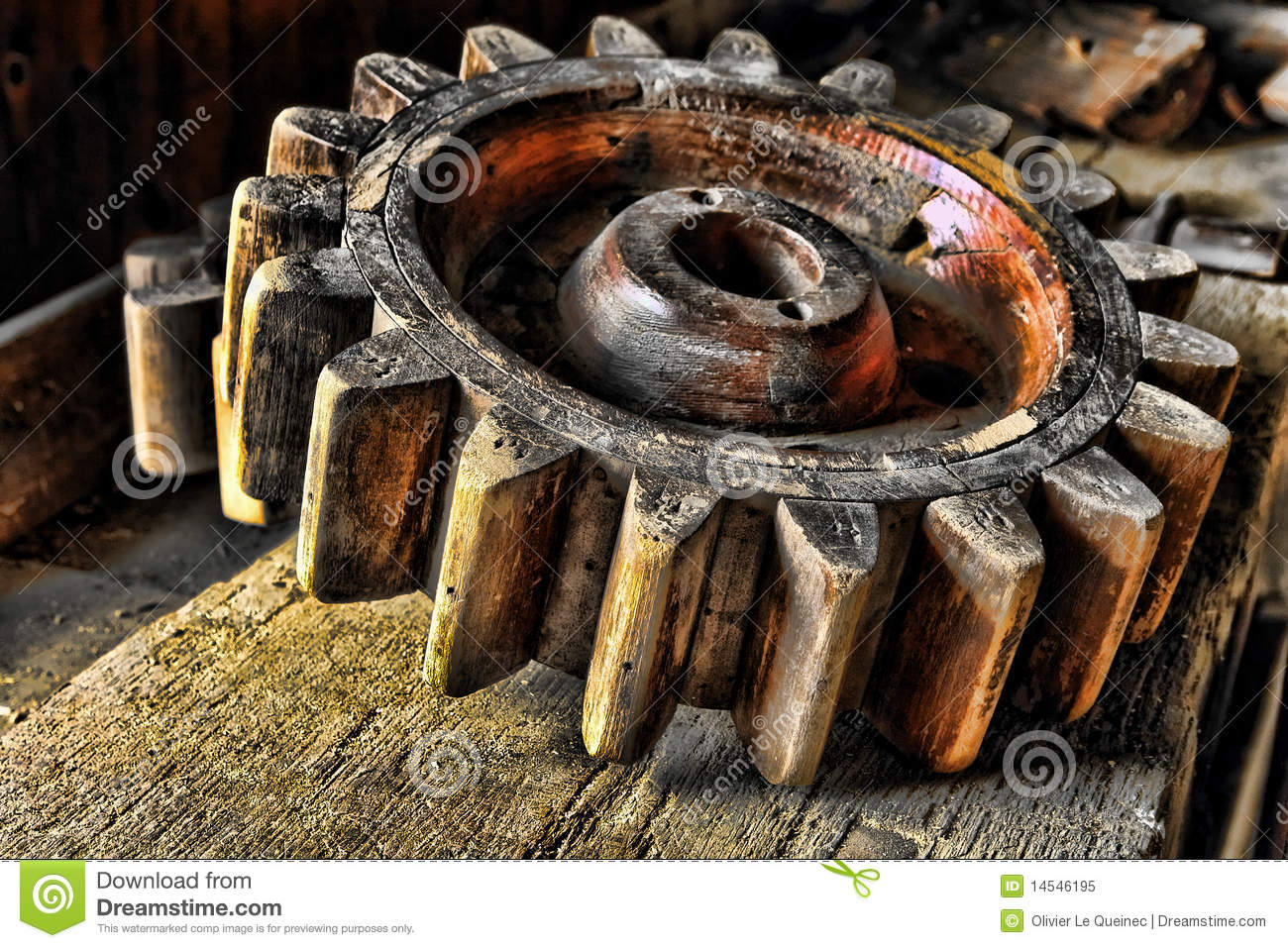 Antique Wood Machinery Wheel on Old Wooden Bench