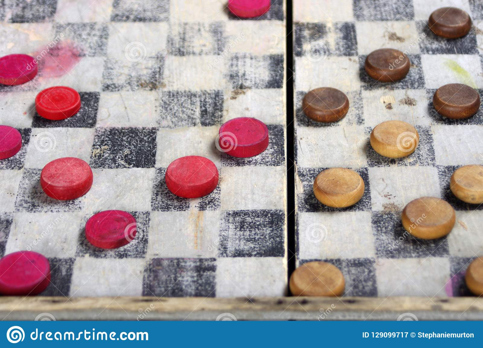 Antique wooden checkers board game