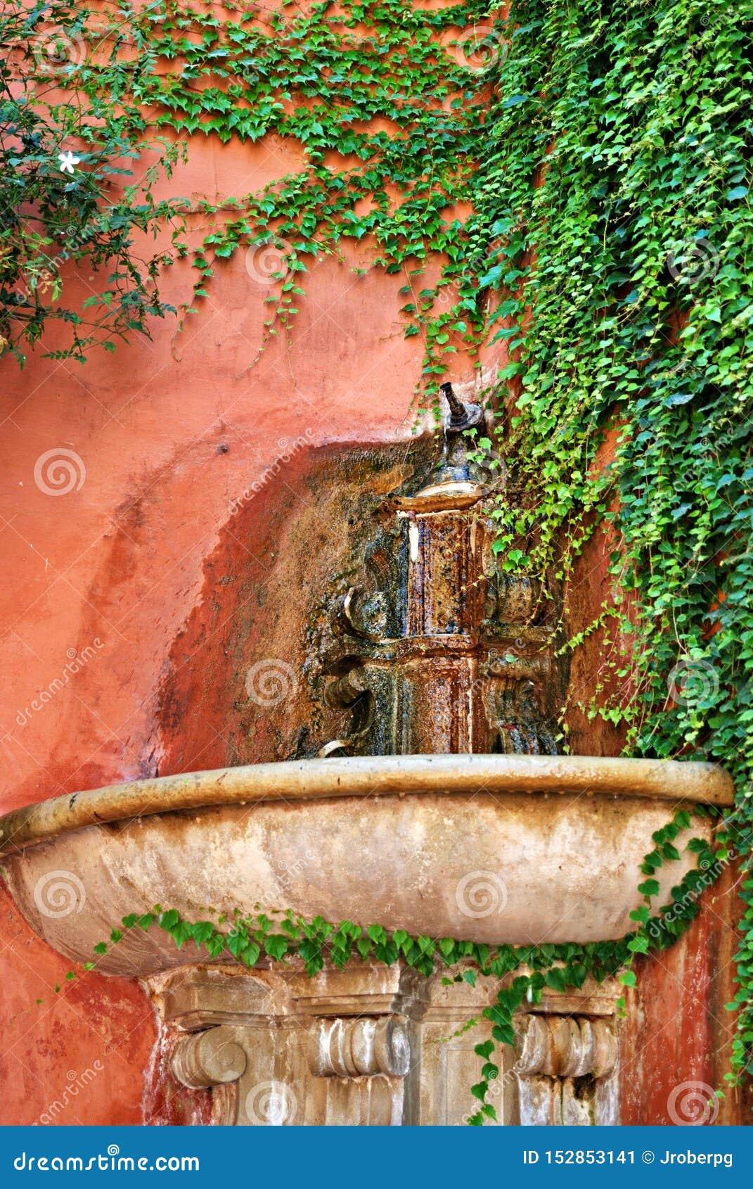 Antyczny źródło świeża woda w kącie Seville