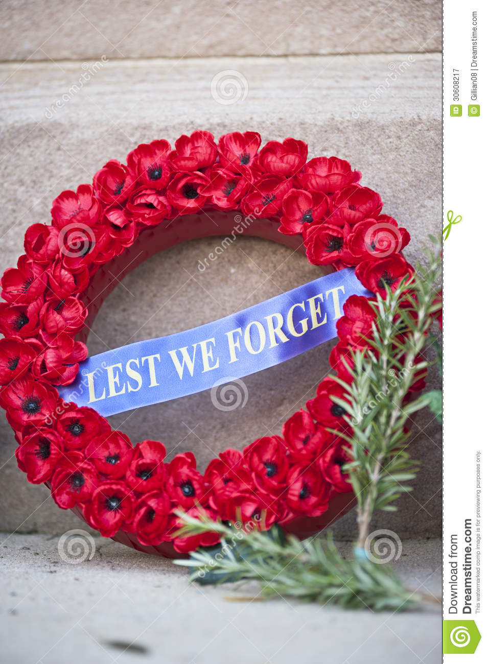 Anzac day wreath of poppies. Rosemary, symbolising remembrance, is ...