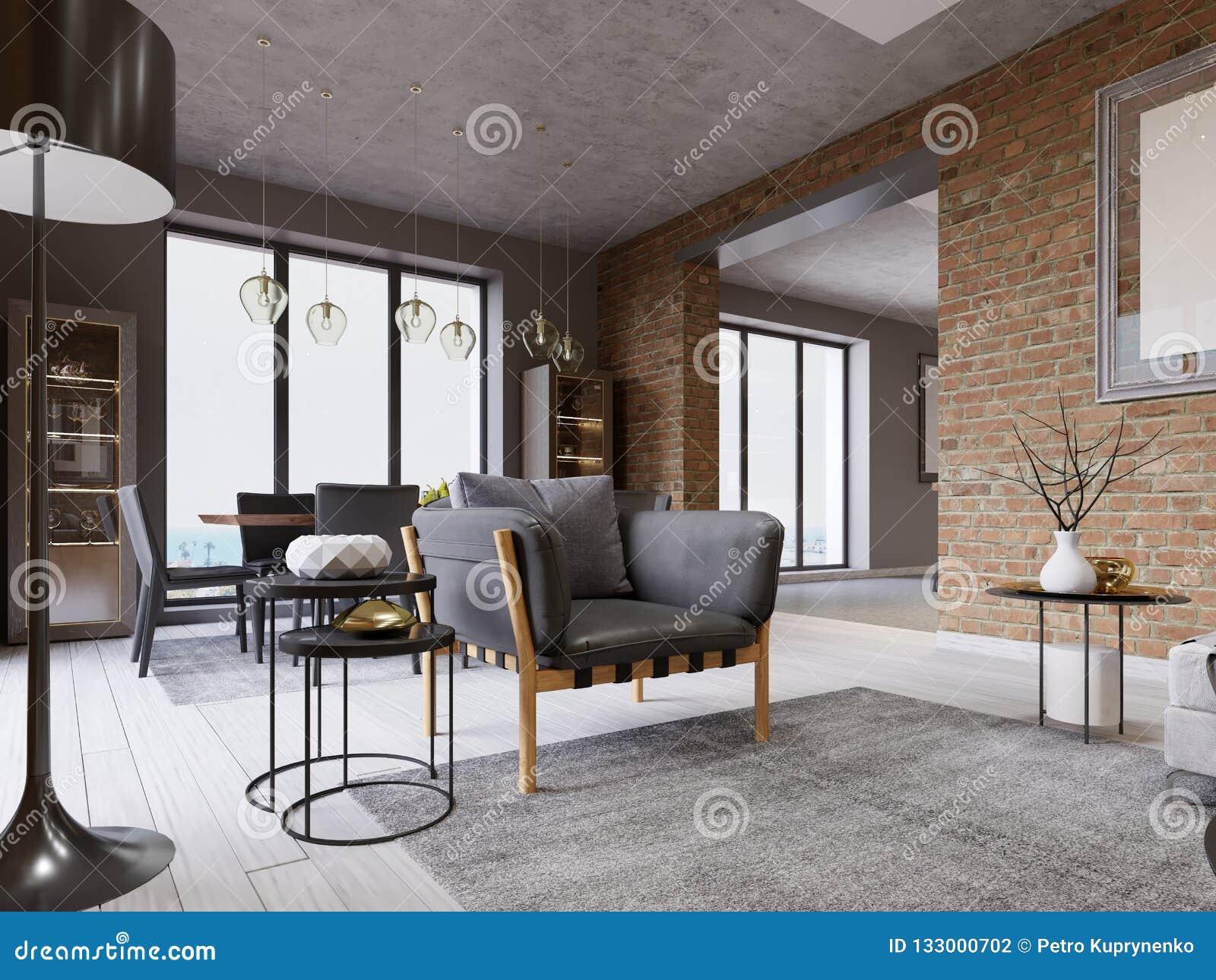 Apartamento-estudio con la butaca de moda del diseñador con la tapicería de cuero, mesa de comedor en una ventana grande, pared d