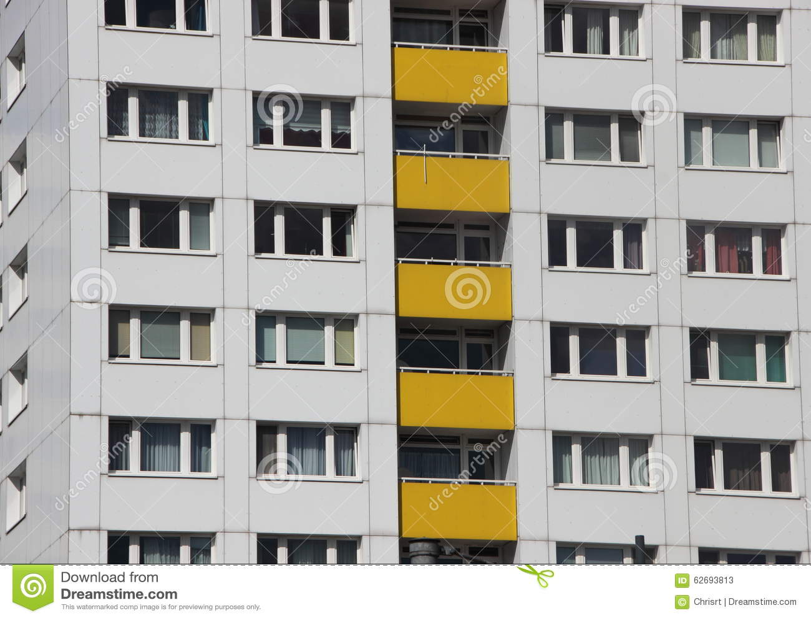 Apartment Building Facade apartment building facade with yellow color balcony stock photo