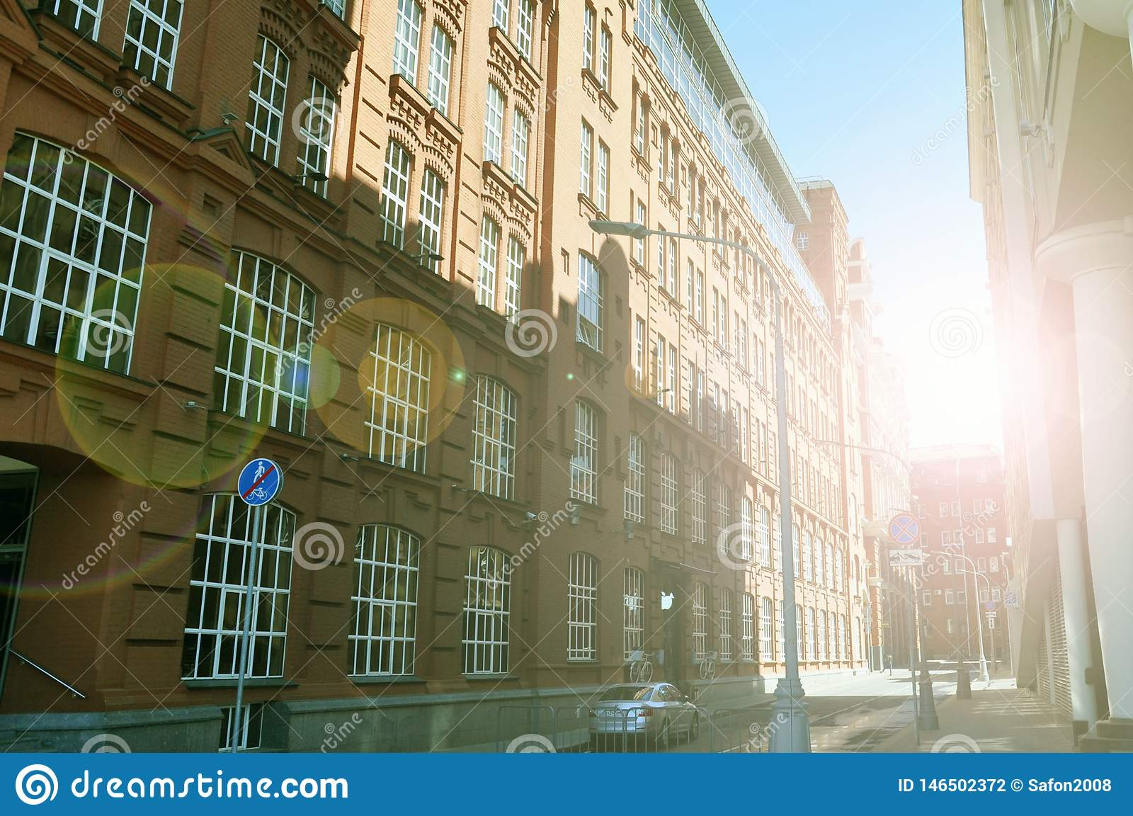 Apartment building on the street flooded with sunlight, Moscow, Russia