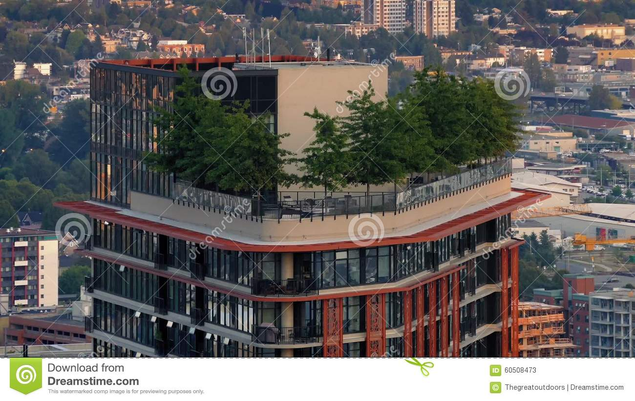 Apartment Building With Trees On Top In The City Stock Video