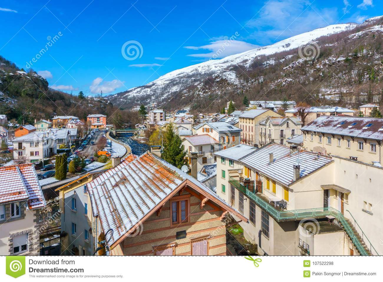 Apartments and hotel of French mountain ski resort in summer sunny day, Ax-les-Thermes