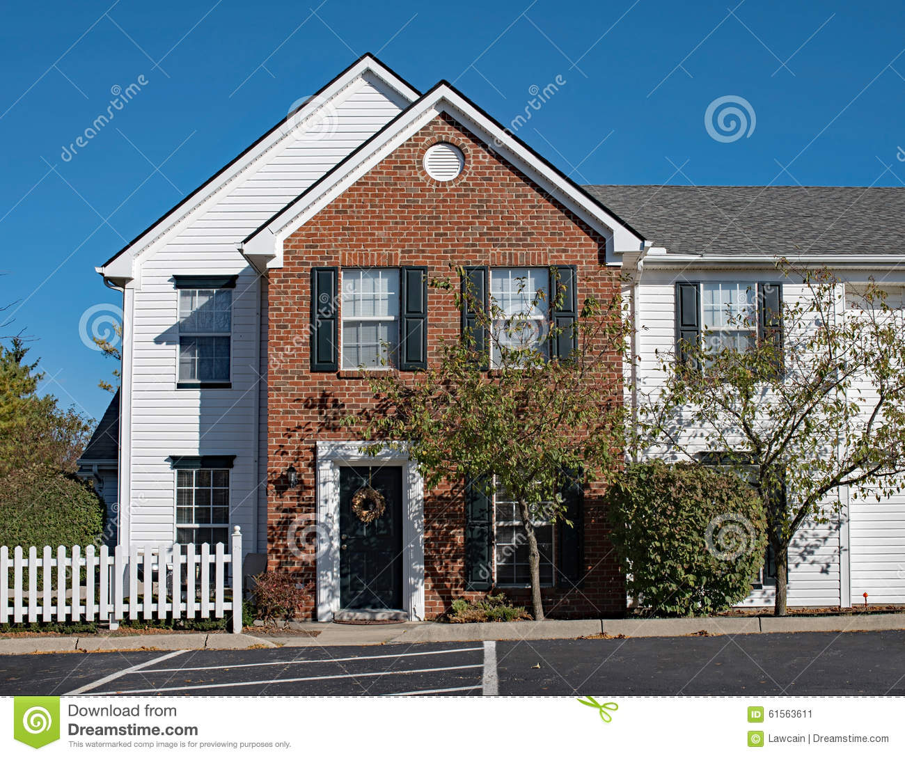 Townhouse Apartments: Apartments Living With White Picket Fence Stock Photo