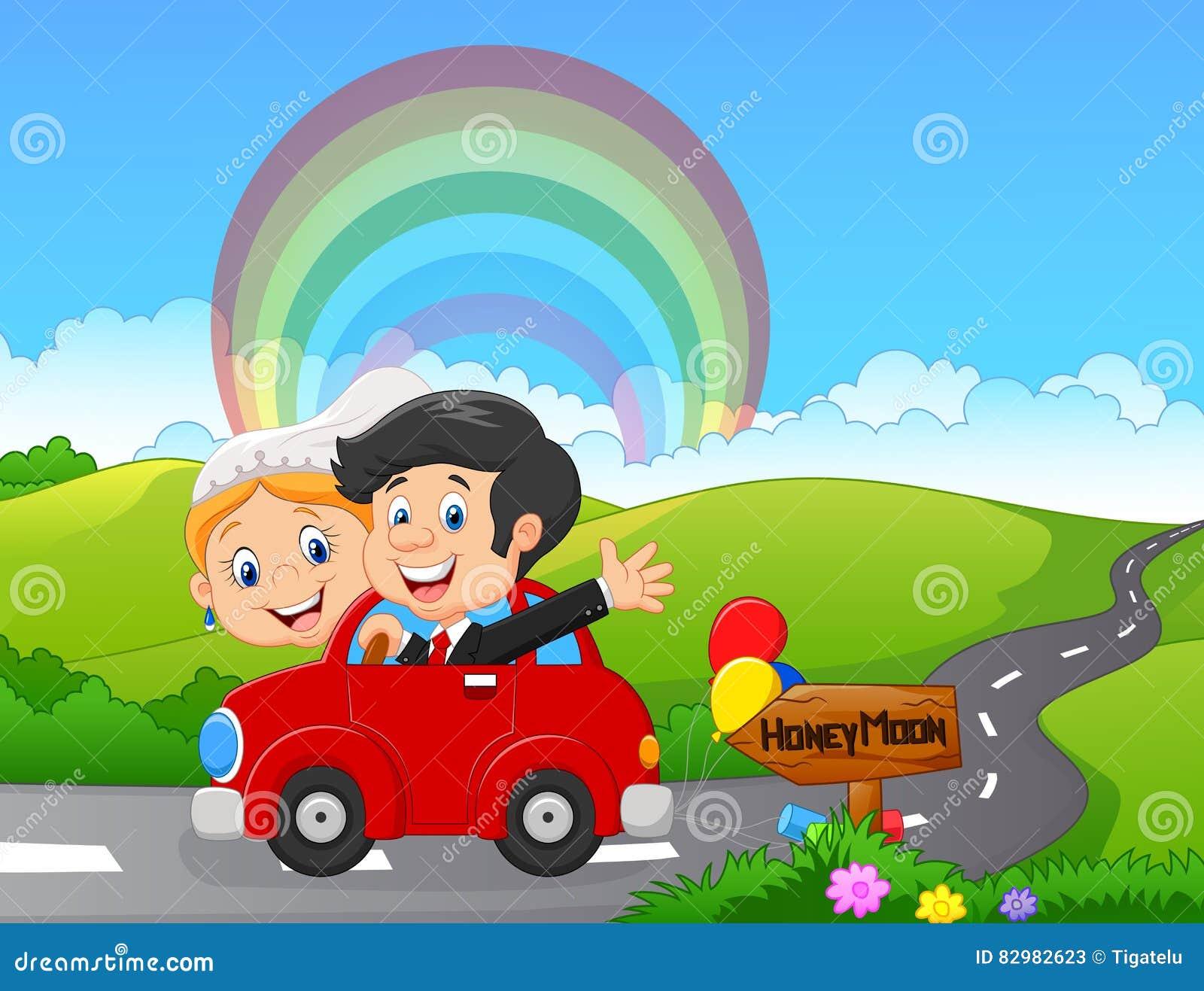 Apenas casal que conduz um carro na viagem da lua de mel