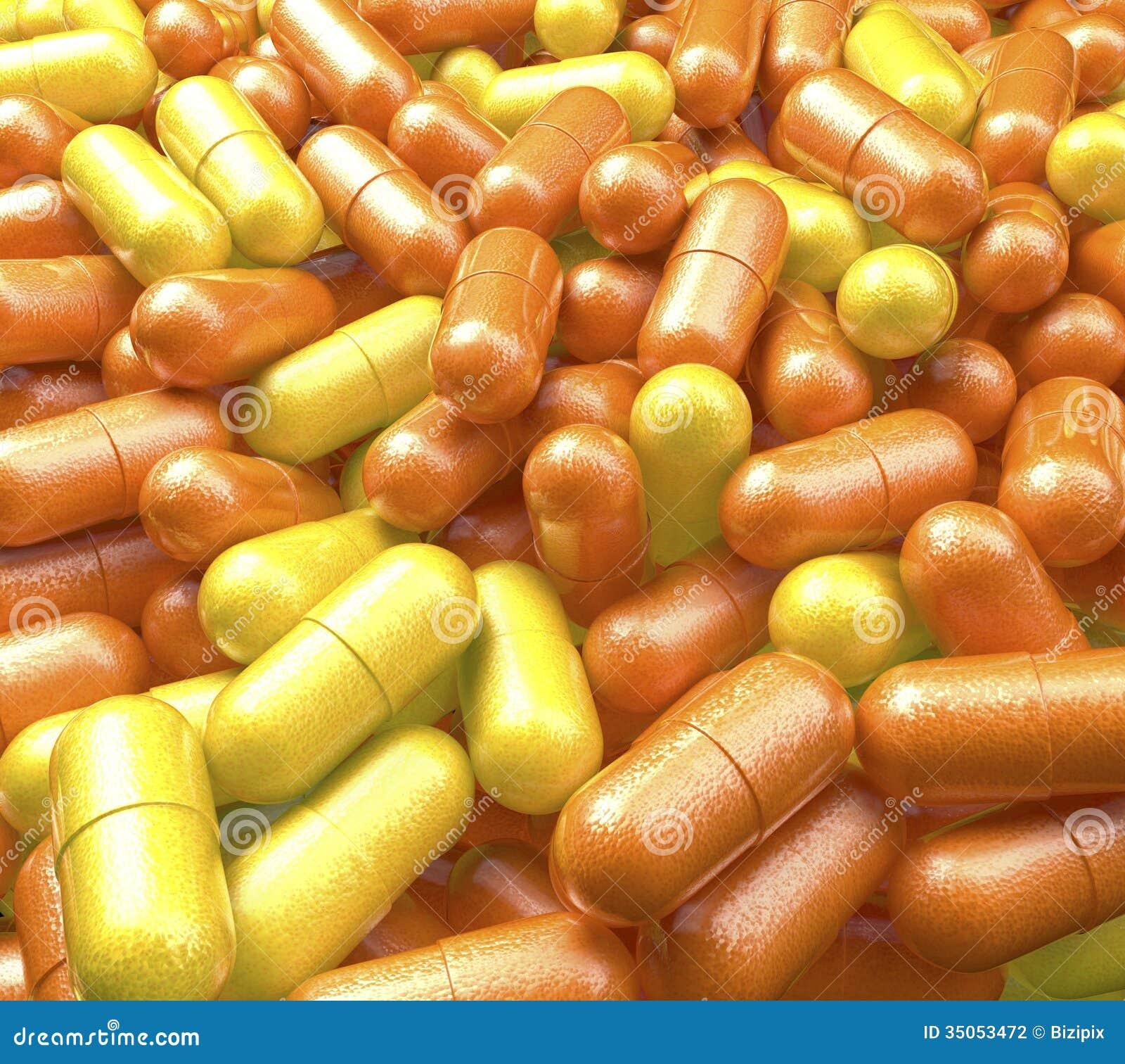 Apile, piscina de las píldoras de la vitamina con la naranja y superficie del limón, tabletas de la medicina