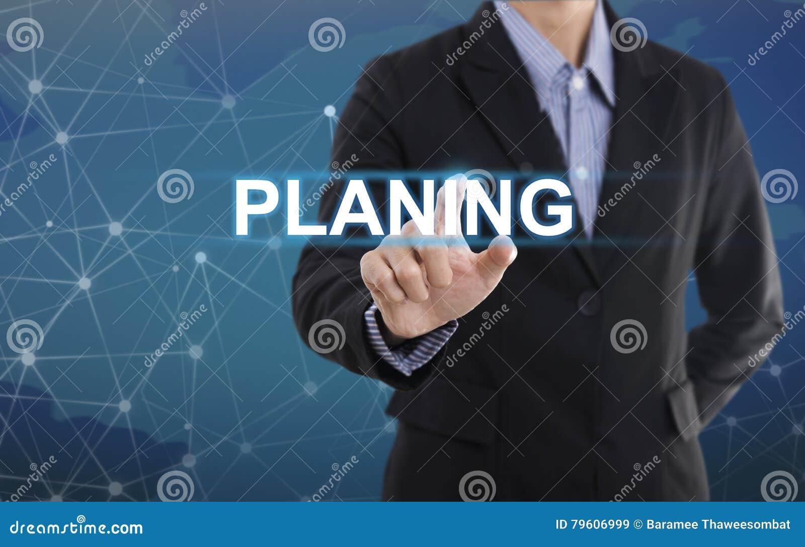 Aplanamento do botão da pressão de mão do homem de negócios