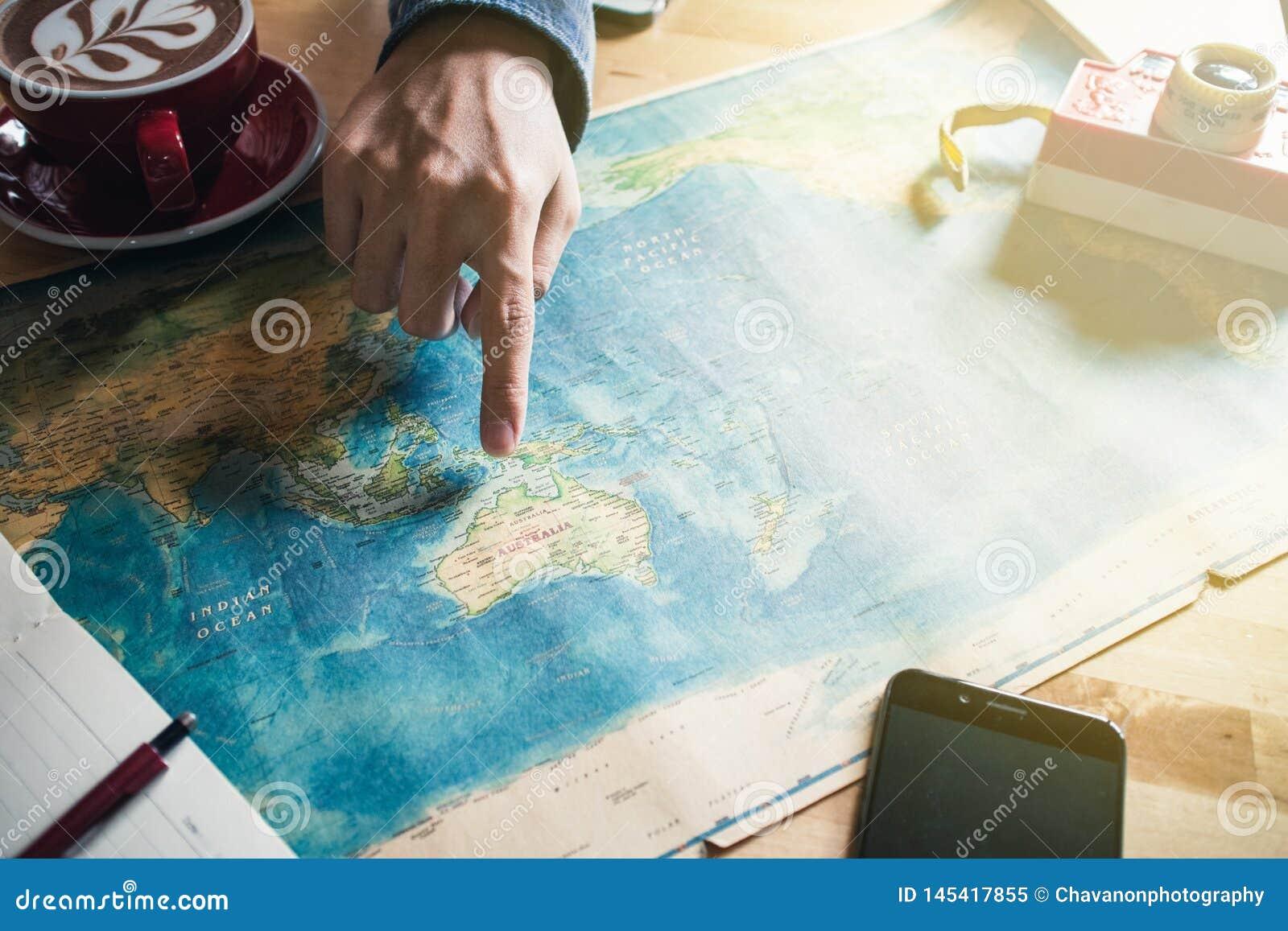 Apontar em um país no mapa do mundo F?rias do planeamento