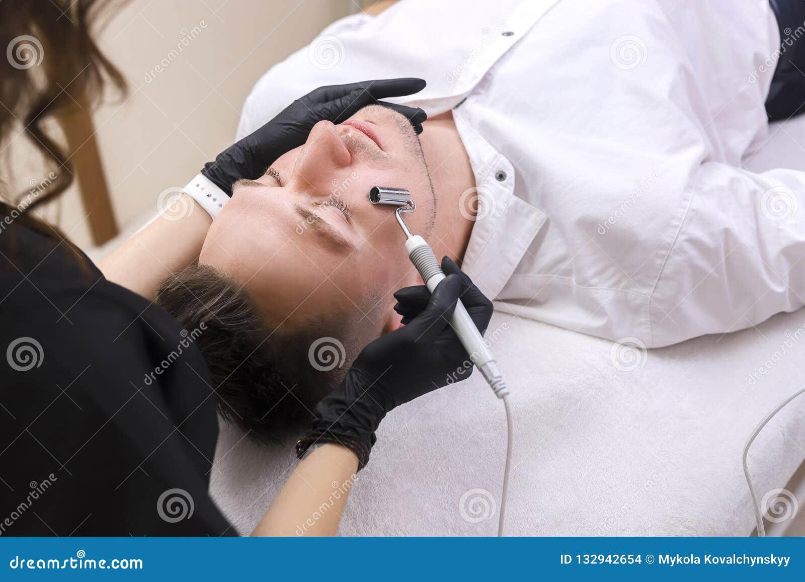 Apparaten är ansikts- cosmetology