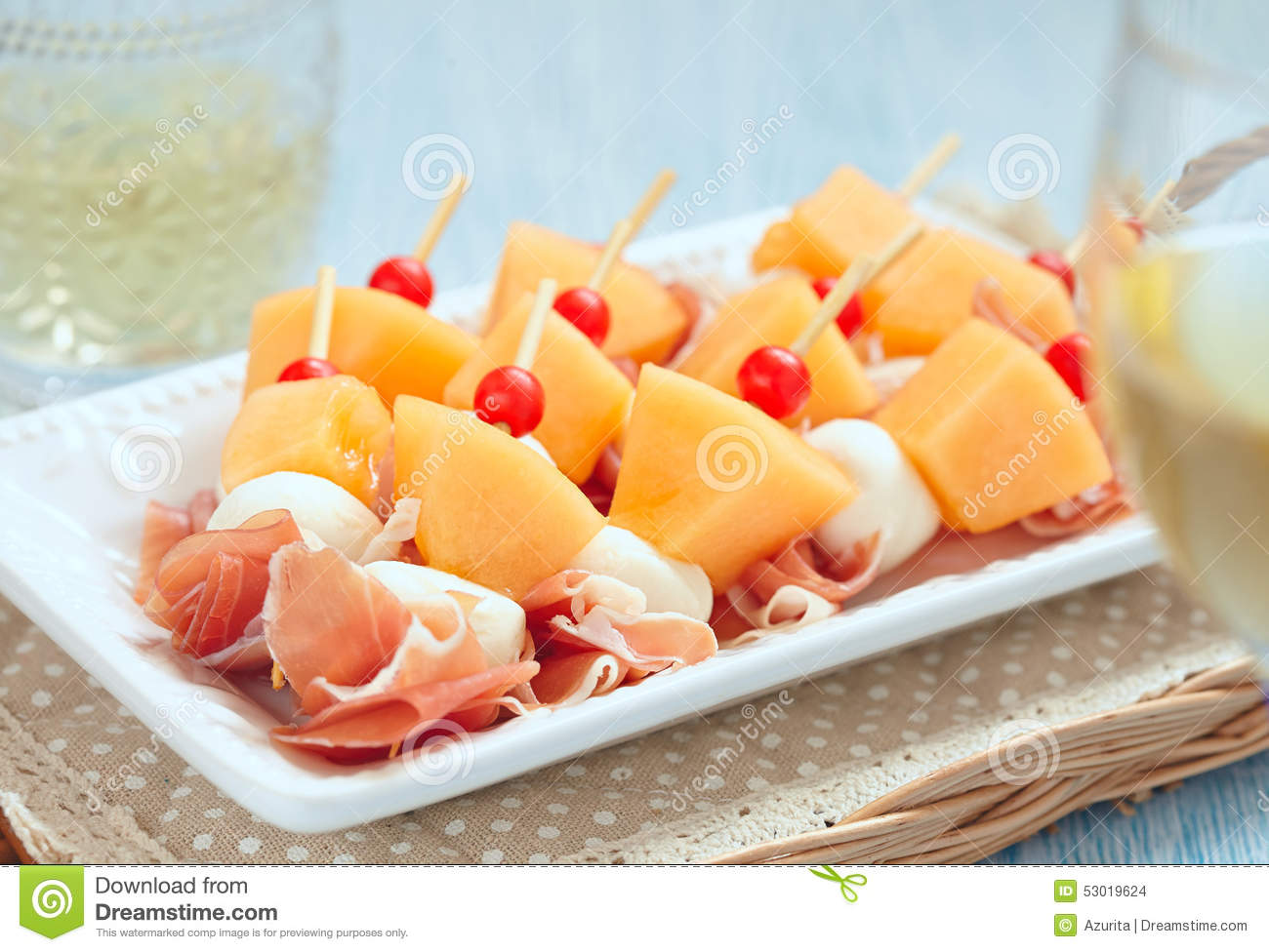 Appetizer with melon cheese and ham stock photo image for Prosciutto and melon canape