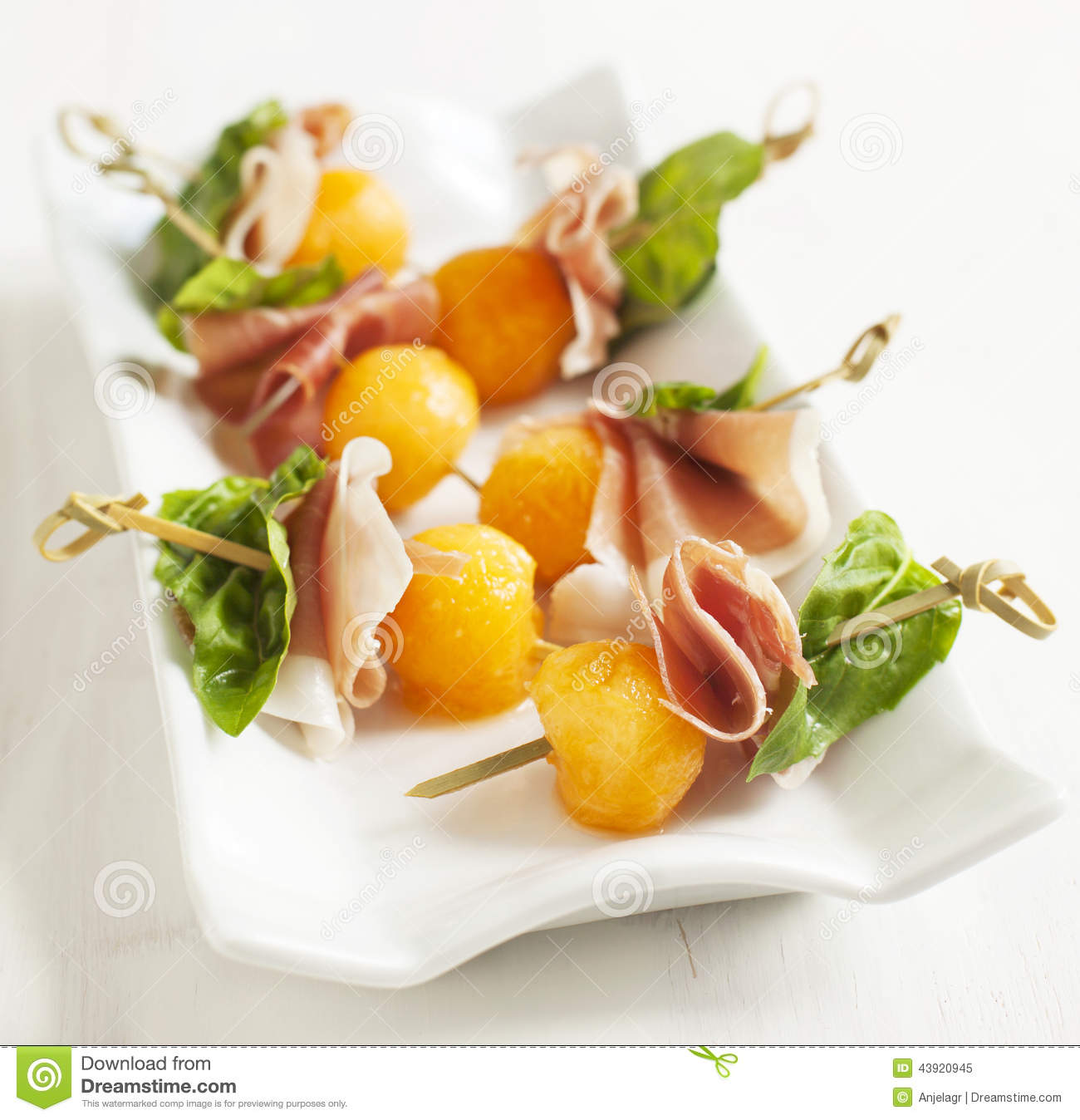 Appetizer with melon and prosciutto on skewers stock image for Prosciutto and melon canape