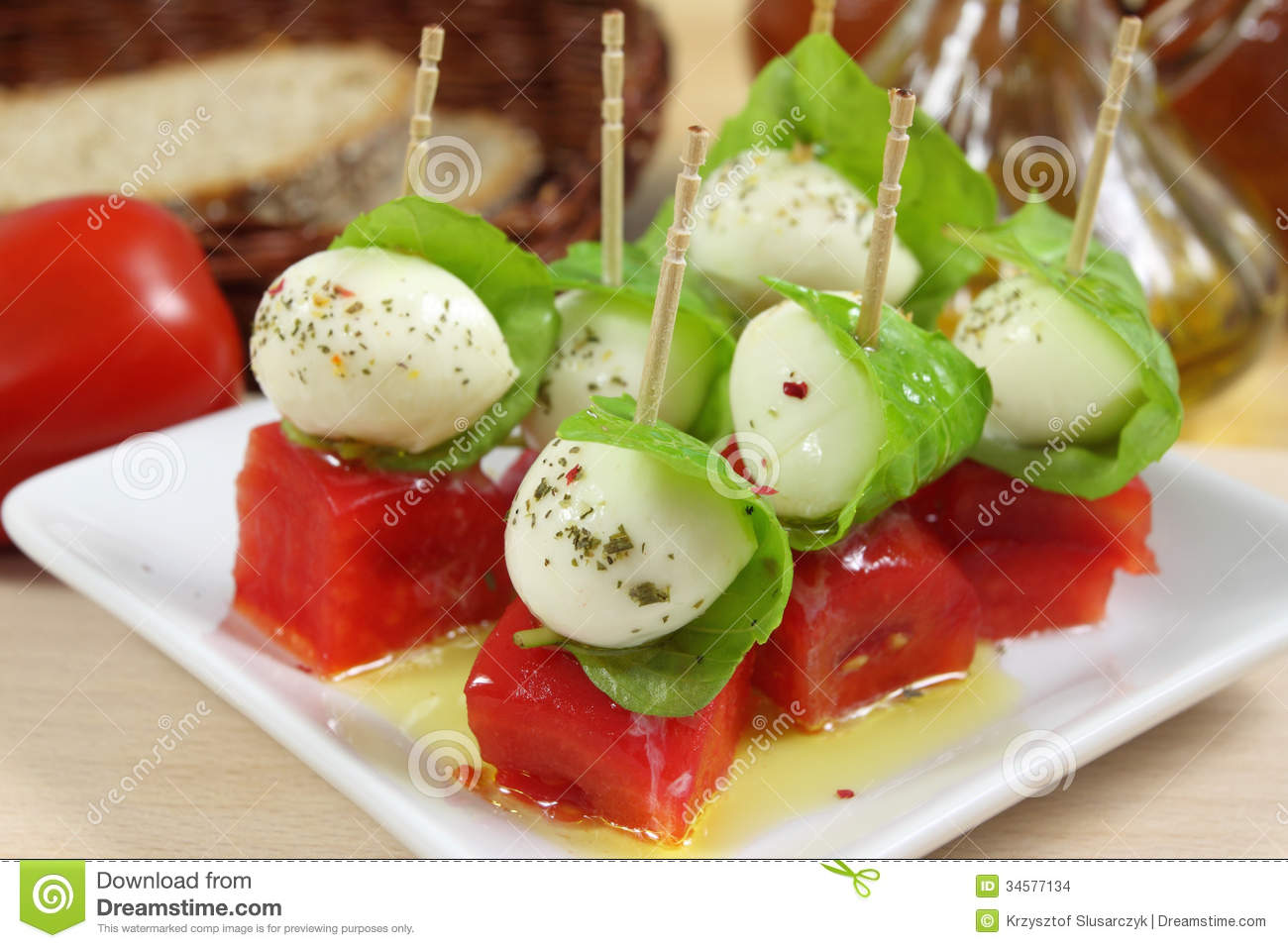 Appetizer with mozzarella, tomato and basil.
