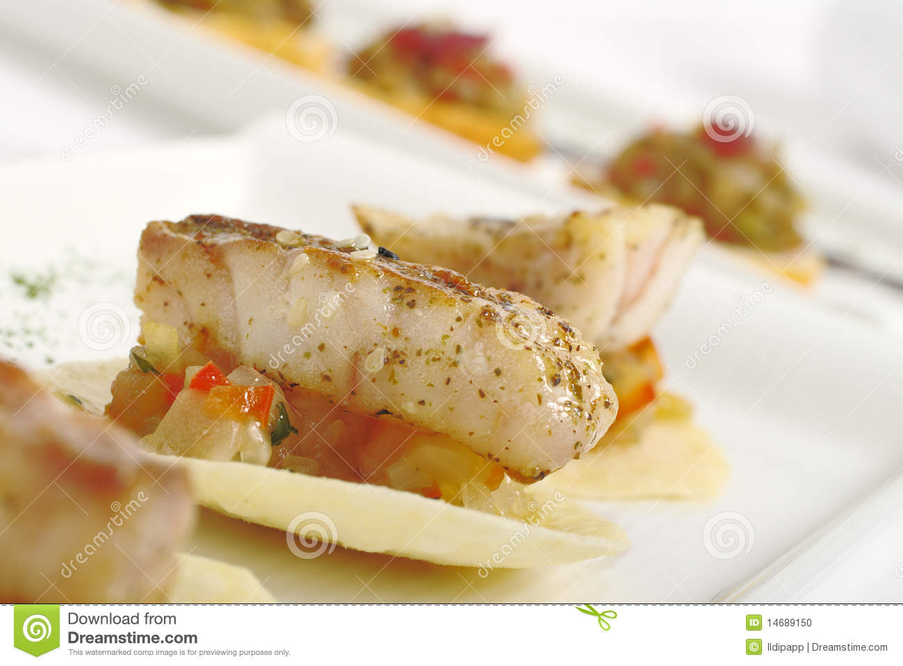 Appetizer piece of fish on vegetables stock photo image for Piece of fish