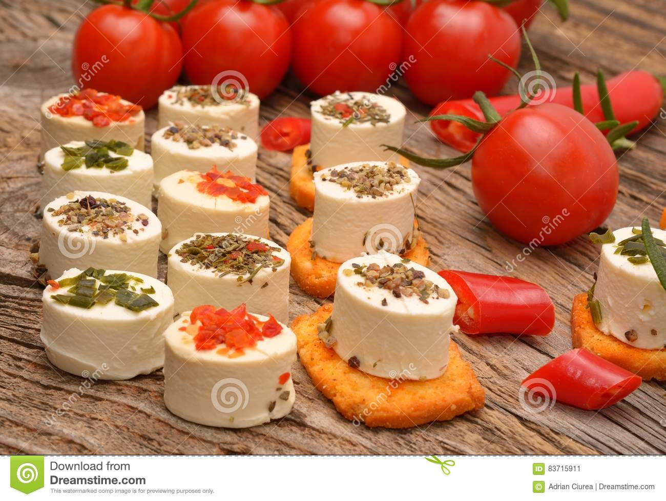 Appetizers Cheese And Bruschetta With Herbs, Tomato And Chilli Peppers Stock Photo