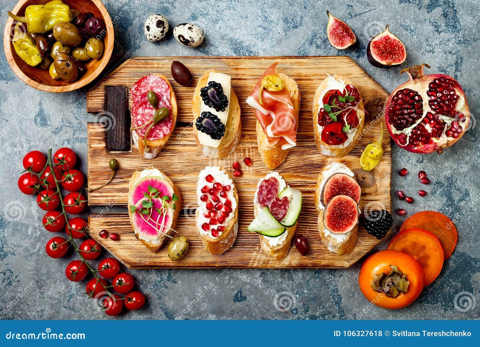 Appetizers table with italian antipasti snacks. Brushetta or authentic traditional spanish tapas set