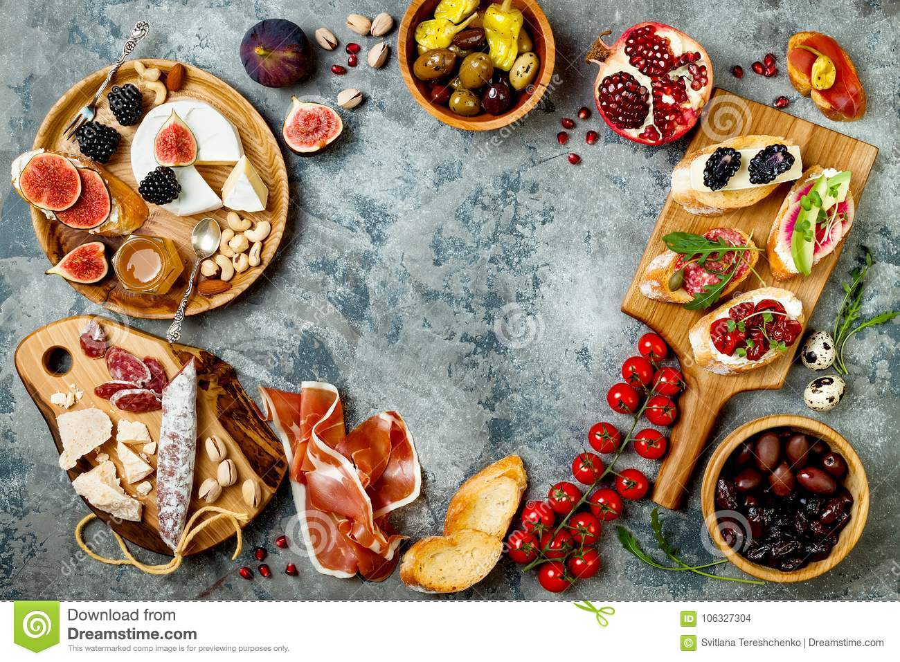 Appetizers table with italian antipasti snacks. Brushetta or authentic traditional spanish tapas set, cheese variety board