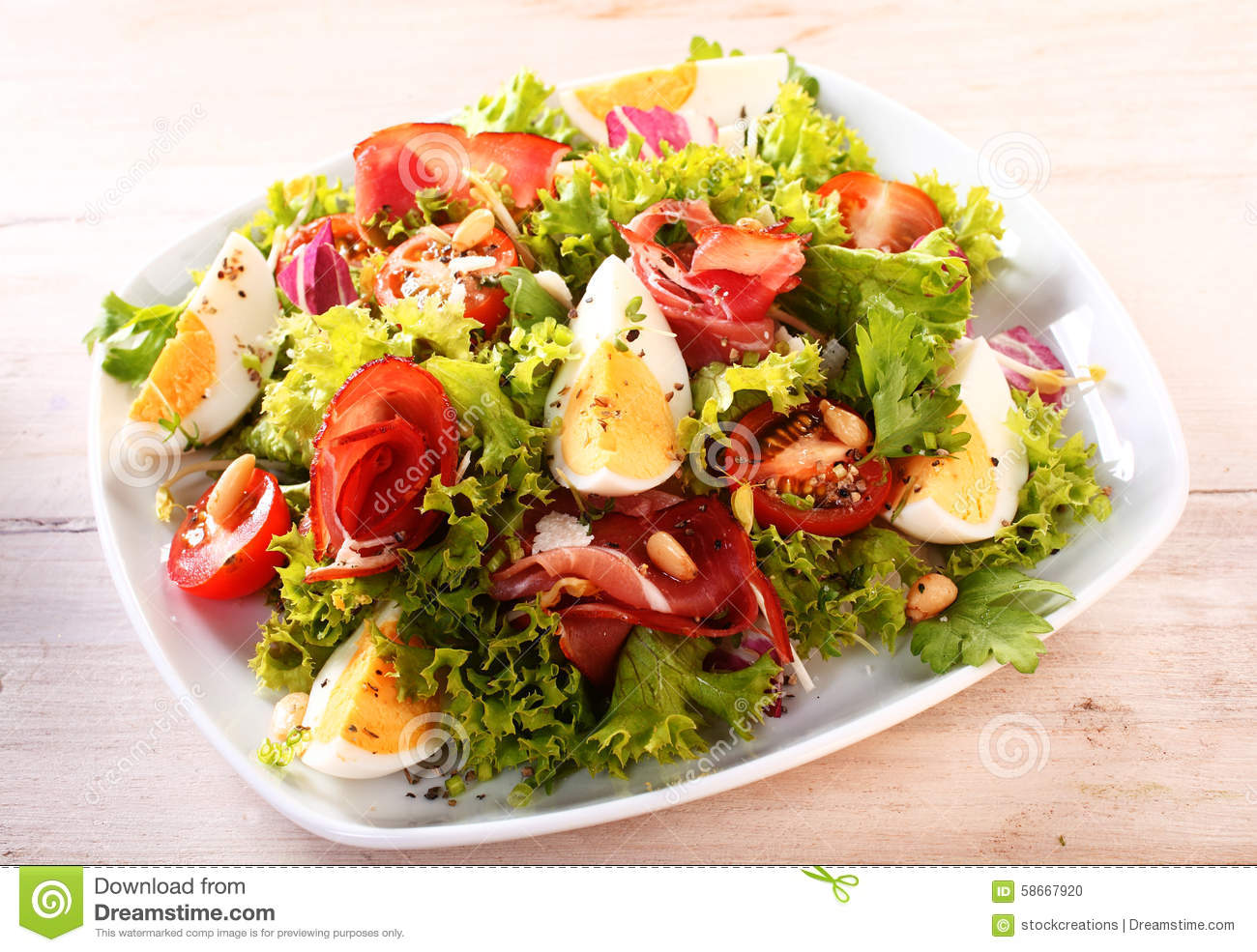 Appetizing Vegetable Salad With Egg Slices Stock Photo ...