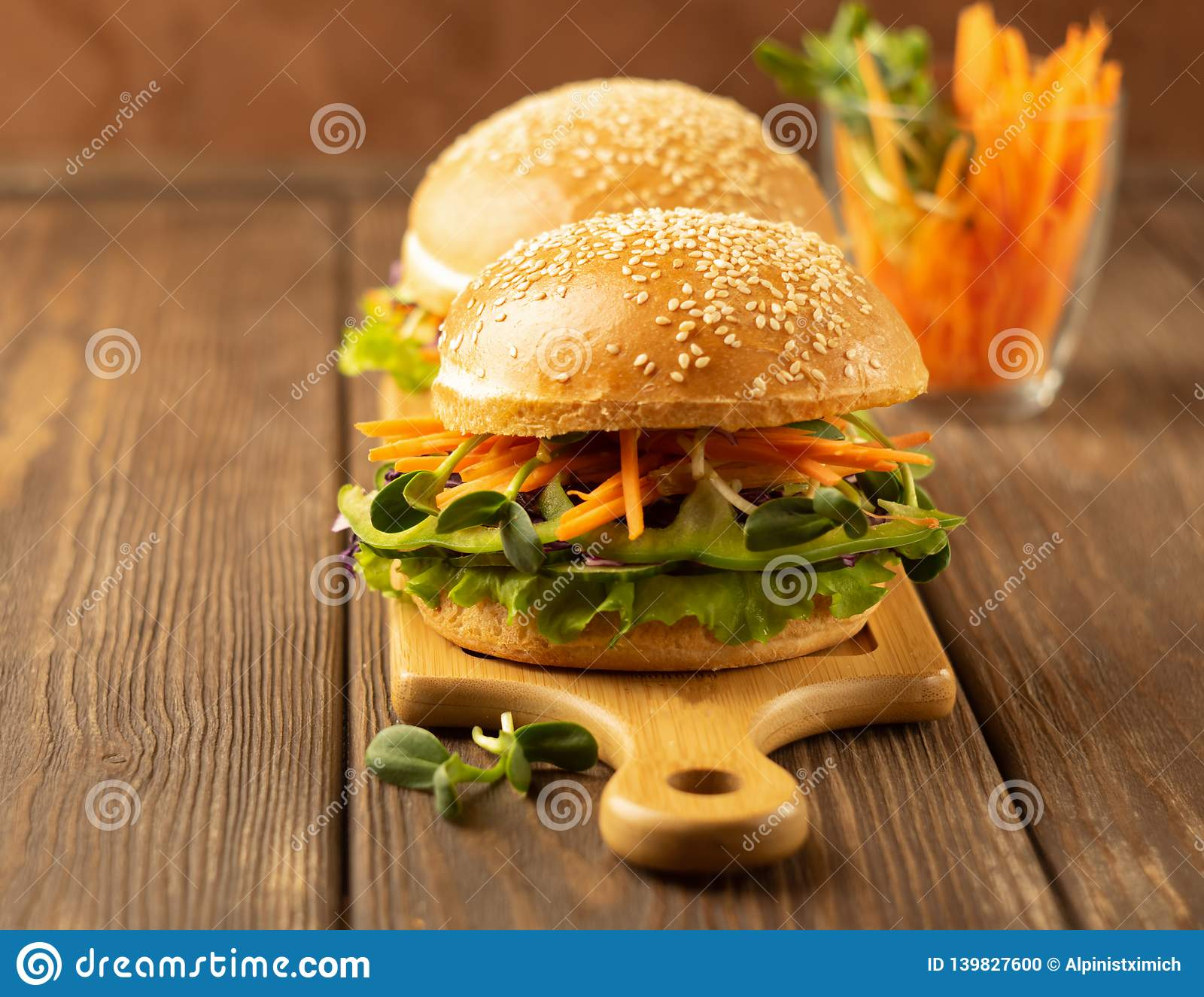 Appetizing veggie sandwich with fresh vegetables on a dark brown background. The concept of proper nutrition.