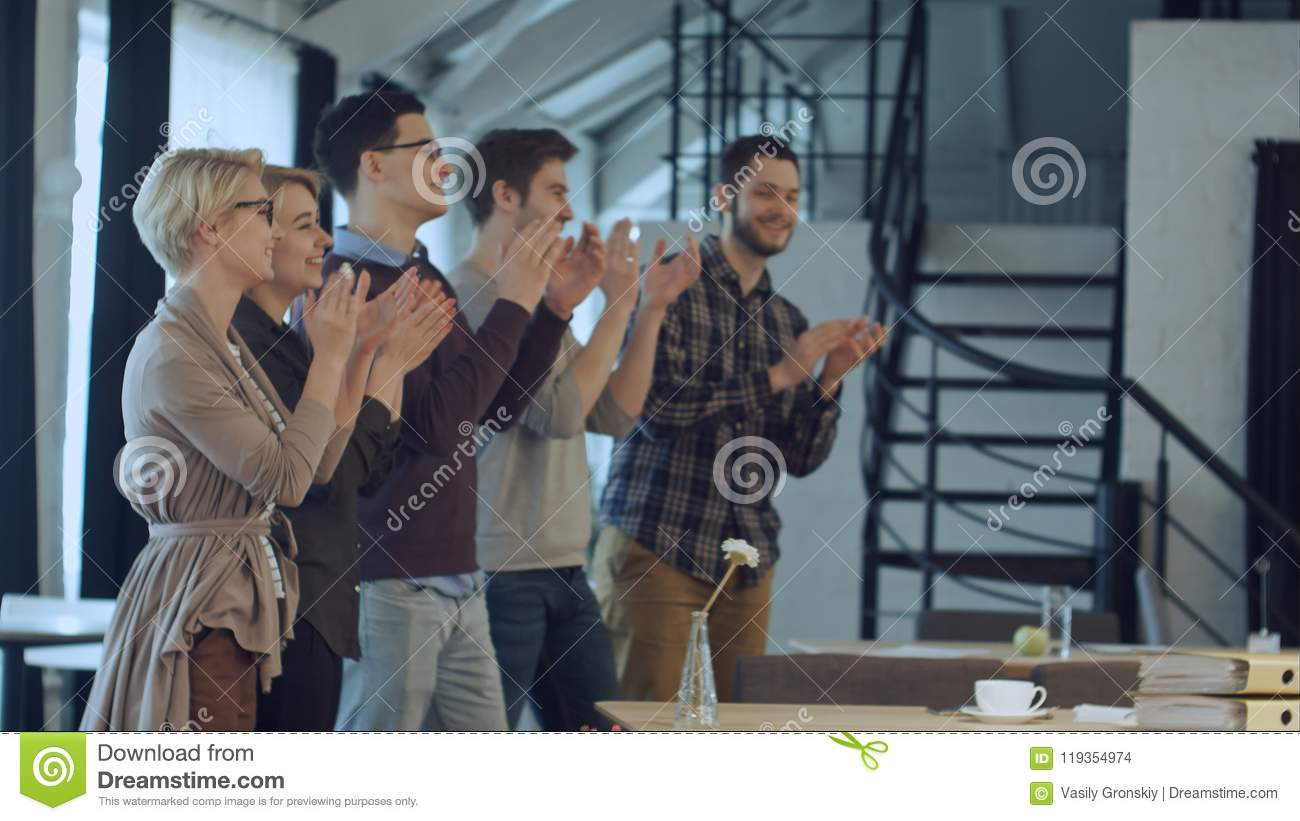 Applause of business startup people in the office as team