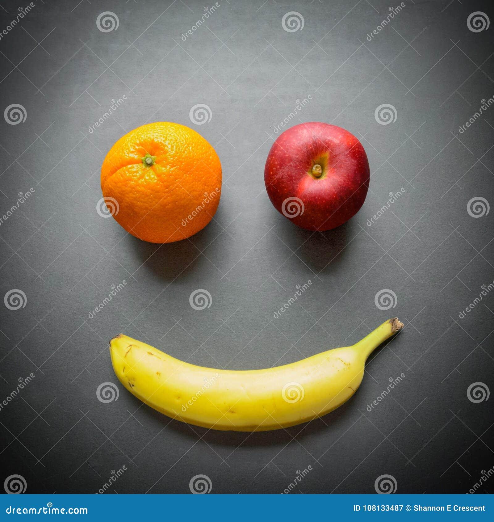 Apple, banana, and orange as a smiley face