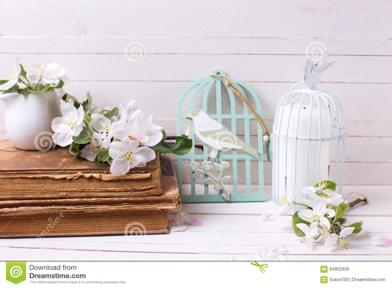 Apple Blossom, Old Books And Candle In Decorative Bird Cage