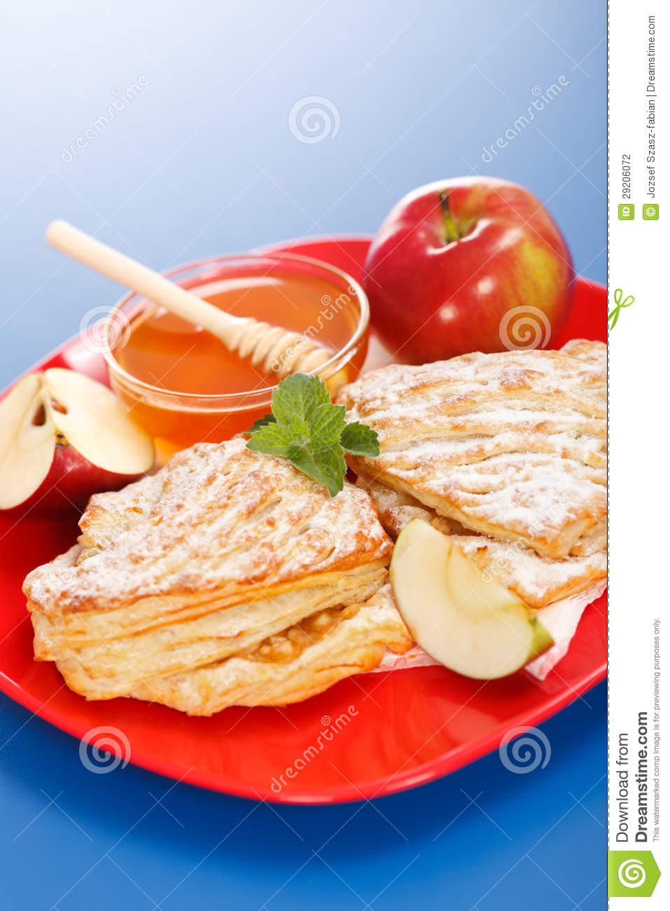 Apple Cakes On Plate, Honey And Apple Pieces Around Stock Photography ...