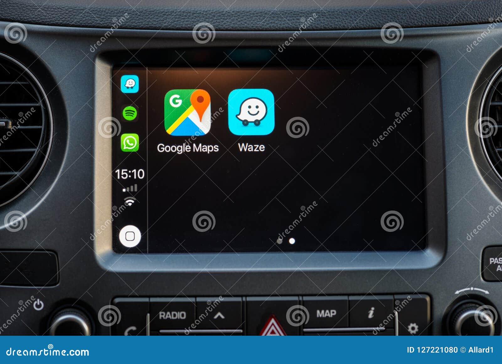 Apple Carplay Screen In Car Dashboard Displaying Google Maps And