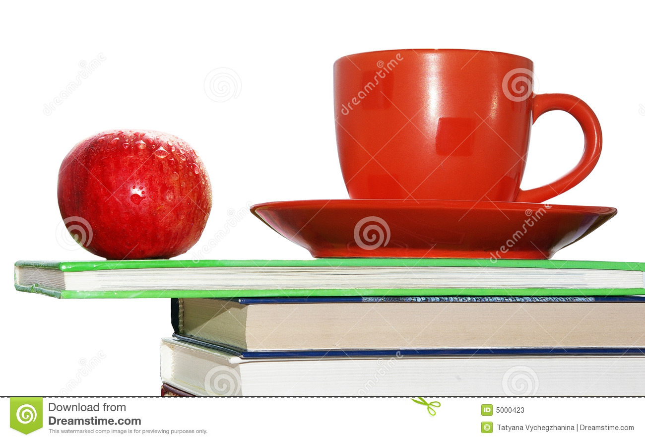 Apple, cup and books