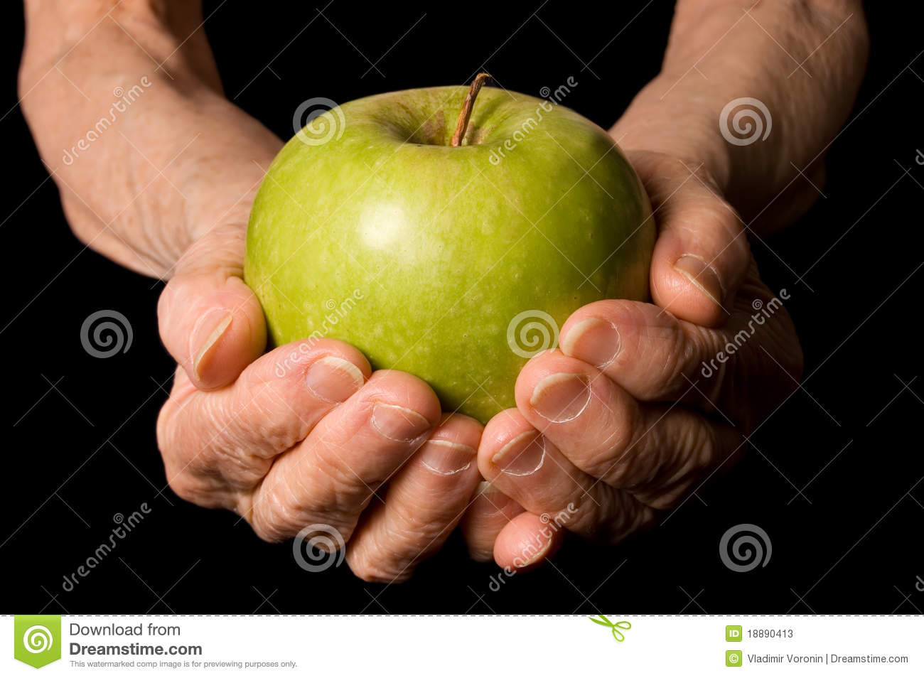 Apple in a hand of the old woman