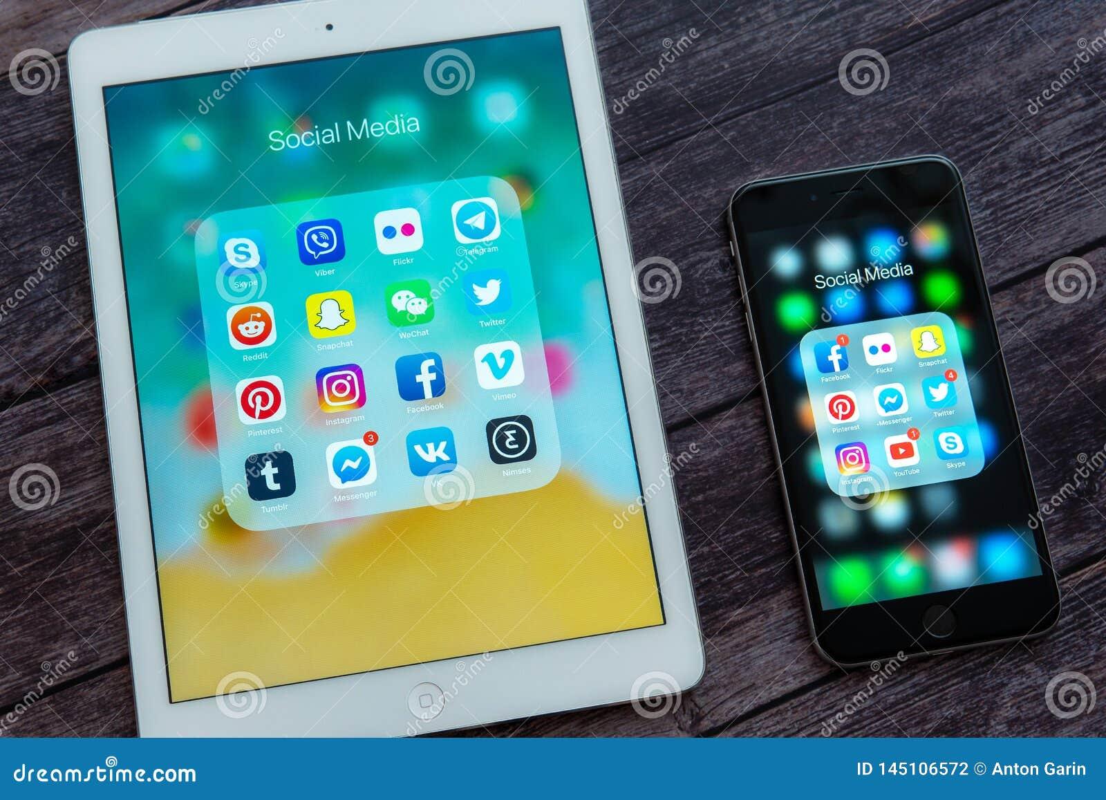 Apple iPad και iPhone με τα διαφορετικά εικονίδια των κοινωνικών μέσων