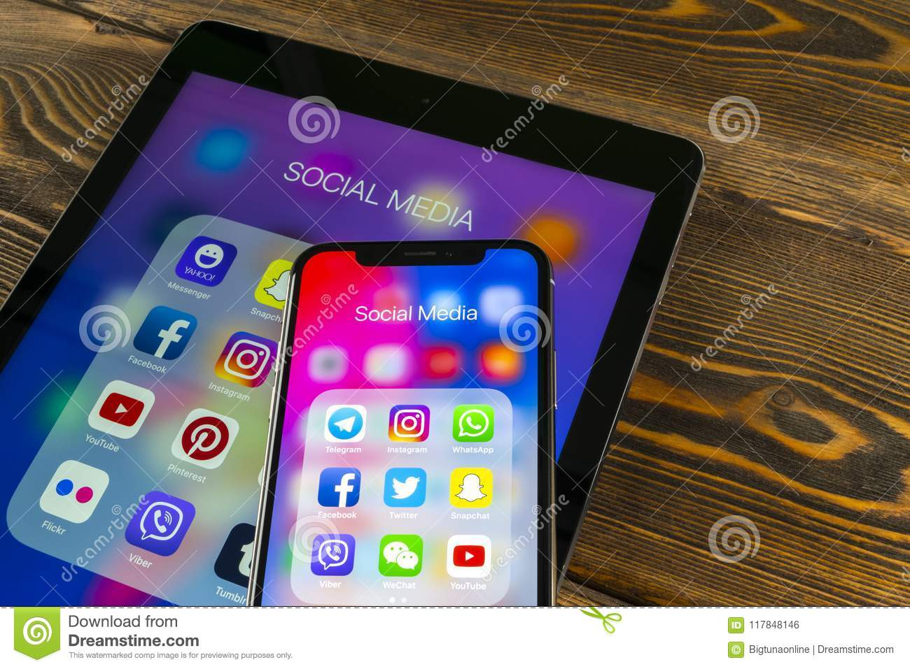 Apple iPad and iPhone X with icons of social media facebook, instagram, twitter, snapchat application on screen. Social media icon
